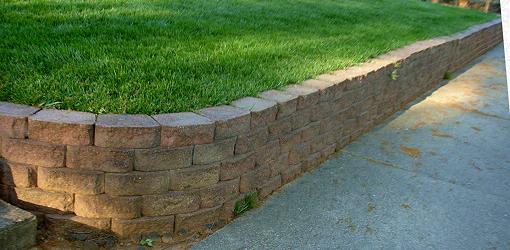 Muro de contención con esquina exterior curvada a 90 °